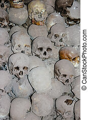 Graves with skulls - The desecration of the human body,...