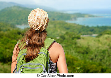 Young traveling woman with backpack focus on traveller -...
