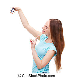 Beautiful young woman taking a picture of herself with her camer
