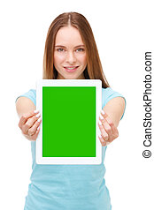 Young beautiful woman holding white tablet with copyspace -...