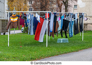 clothes to dry - on a drying rack hanging clothes to dry....