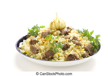 pilau - pilaf with garlic and parsley on white gound