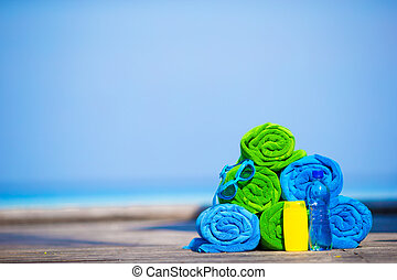 Beach and summer vacation accessories concept - close-up of...