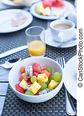 Fresh fruit salad, coffee with milk and juice served for...