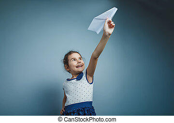 a girl of seven European appearance brunette holding a paper...