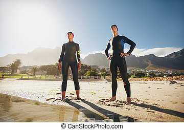 Two athletes ready for triathlon - Portrait of a determined...