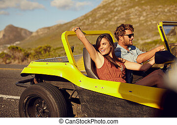 Relaxed couple enjoying in the car ride