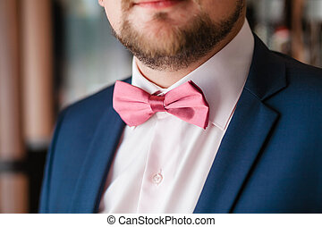 Groom with pink bowtie and beard