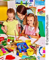 Children with teacher painting - Happy children with teacher...