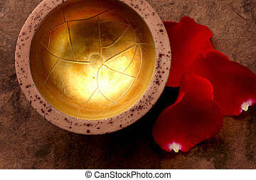 Spa still life - Golden bowl with red rose petals shot on...