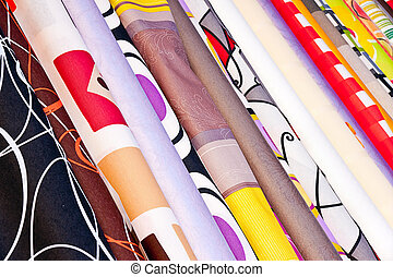Colorful fabric rolls in a market
