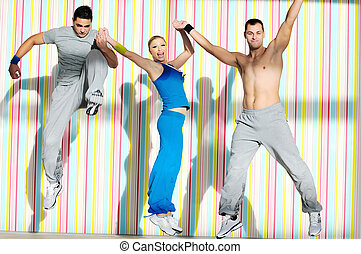young adults group in fitness club - group of young adults...