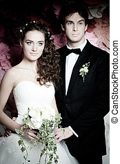 Young couple in wedding gown.
