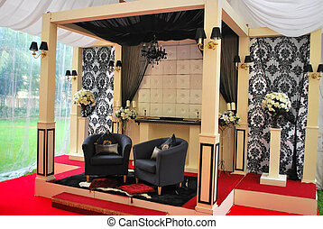 Malay wedding decorations - Decorated and raised stage where...