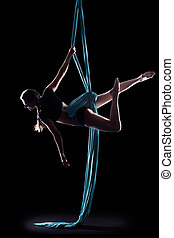 Young woman gymnast with blue gymnastic ribbon isolated on...