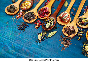 Various types of tea with in wooden spoons