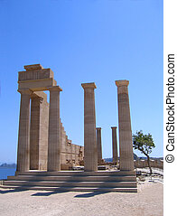 Ruins of ancient Greek temple with columns in summer day....