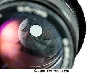 The diaphragm of a camera lens aperture. Selective focus...
