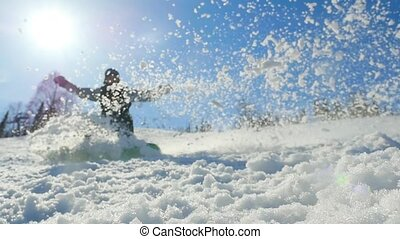 Young man snowboarding on mountains at sun and knocked the...