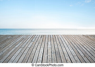 Old vertical striped wooden terrace with sky sea background