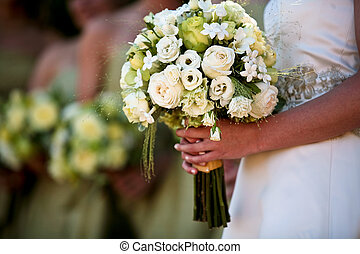 Bridal party - A close up view of a brides hands and bouquet...