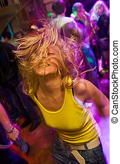Young blond girl on the dancefloor - Blond girl partying in...