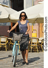 Woman With A Bicycle In A City - Image of a young woman...