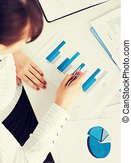 woman hand with charts and papers - business, office, school...