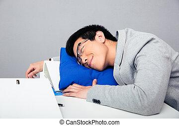 Asian businessman sleepig on the table