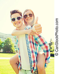 smiling couple having fun and showing thumbs up - summer...