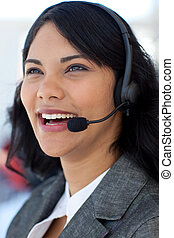 Smiling businesswoman in a call center
