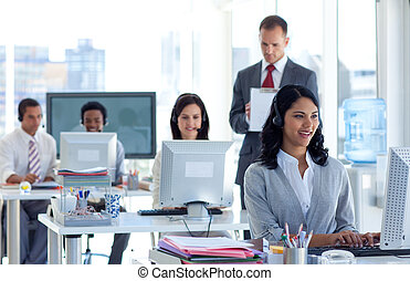 Supervisor taking notes in a call center - Attractive male...