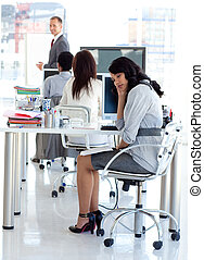 Businesswoman getting bored in a presentation in office