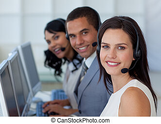 Businesswoman working in a call canter - Smiling beautiful...