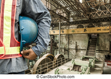 construction worker checking location site with crane on the...