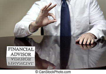 Financial Advisor Holding OK Sign - Financial advisor...