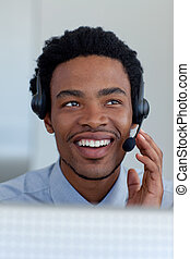Afro-American businessman in a call center - Afro-American...