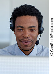 Portrait of Afro-American businessman in a call center -...