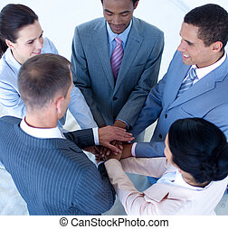 International business team with hands together - High angle...