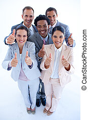 Happy multi-ethnic business team with thumbs up - High angle...
