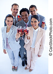 High angle of multi-ethnic business team drinking wine -...