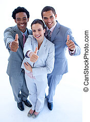 Happy business team with thumbs up - High angle of happy...