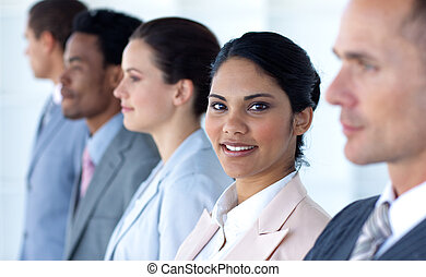 Confident businesswoman with her team in a line