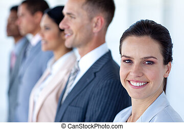 Smiling businesswoman with her team in a line