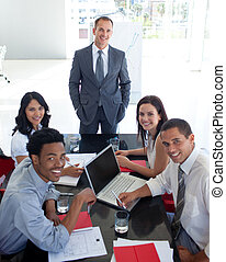 Business people smiling in a meeting - Business people...