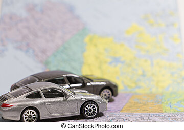 Car small toys on paper map - Closeup car small toys on...