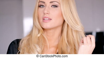 Face of a Pretty Smiling Woman with Blond Hair - Close up...