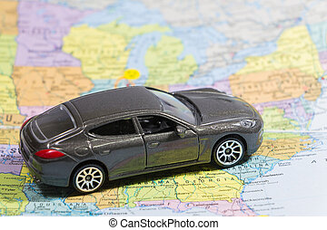 Car (small) toys on paper map - Closeup car (small) toys on...