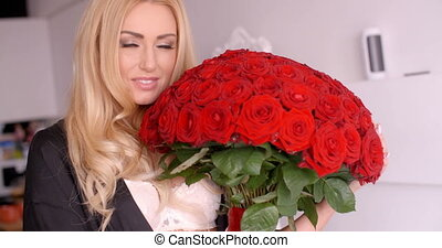 Happy Woman with Fresh Red Rose Flower Bouquet - Close up...