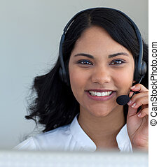 Portrait of a businesswoman talking in a call center